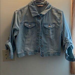 Cropped light wash jean jacket.